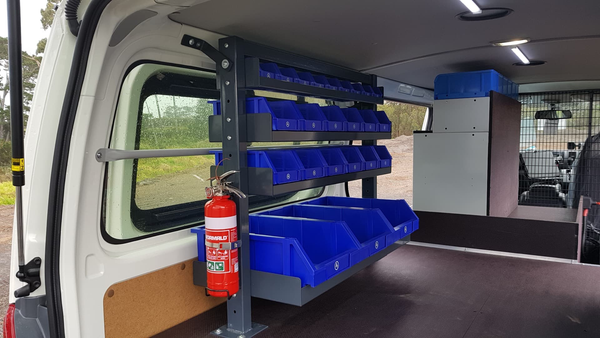 Commercial van fit out with modular tool box racking