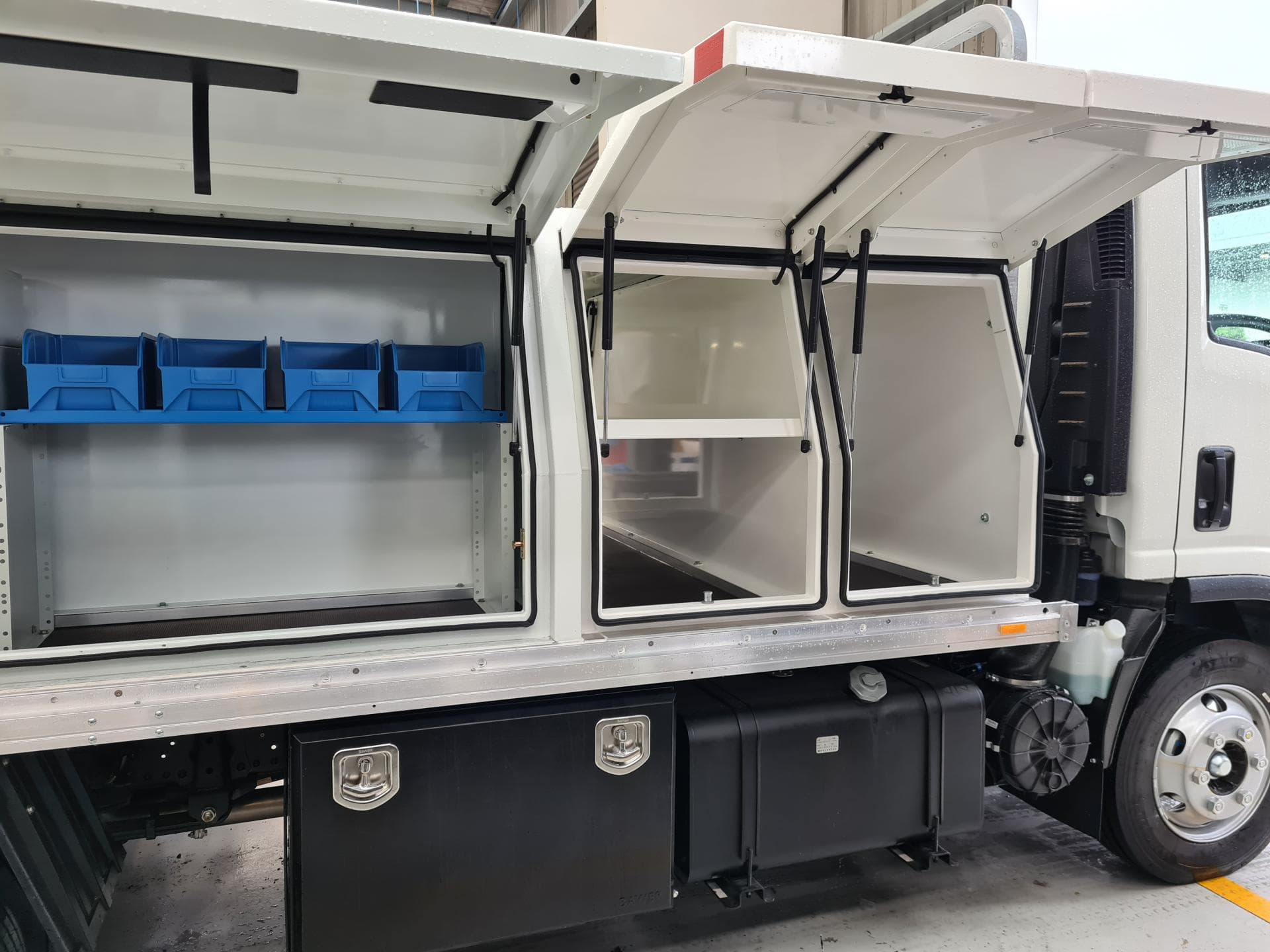 Commercial truck fitout with storage compartments