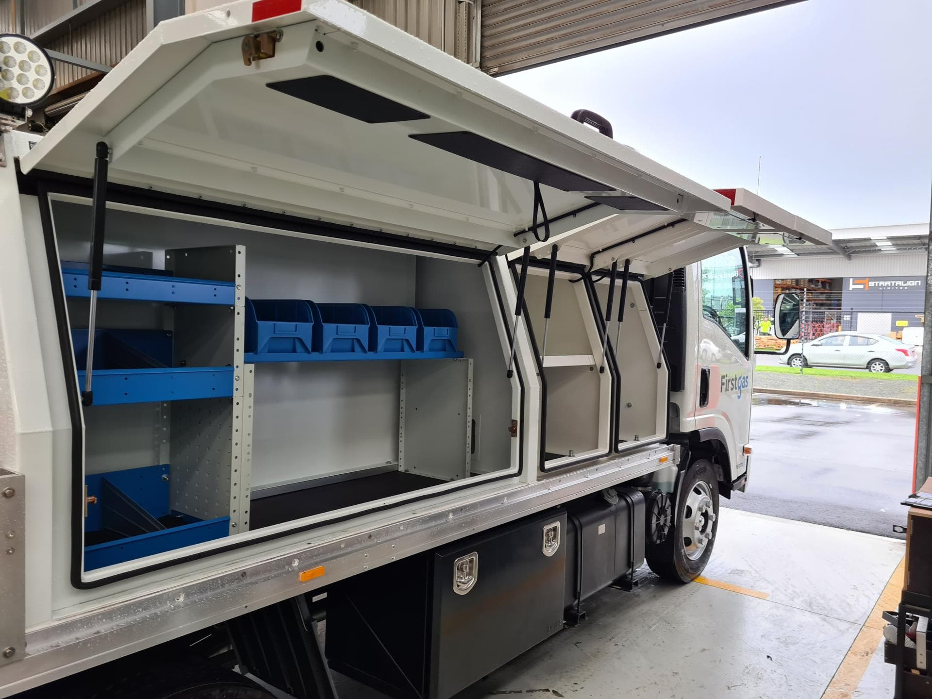 Commercial truck fitout with separate doors and modular storage