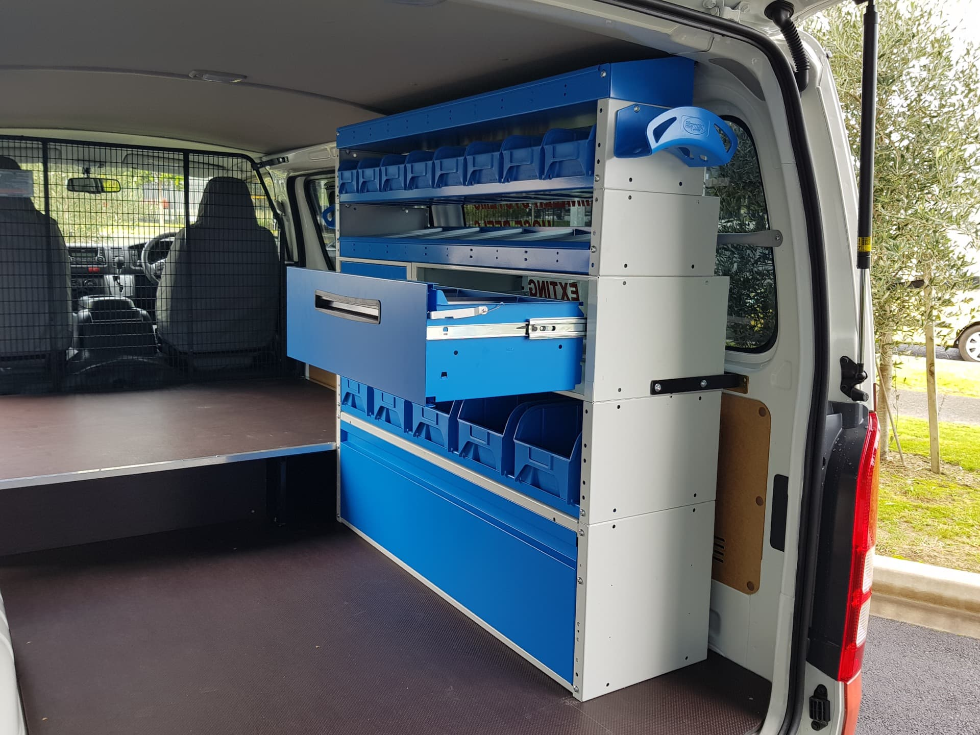 Commercial van fitout rack with drawers and shelves