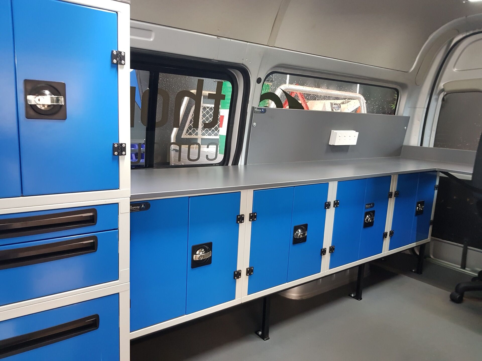 Commercial van fitout with workbench and storage setup