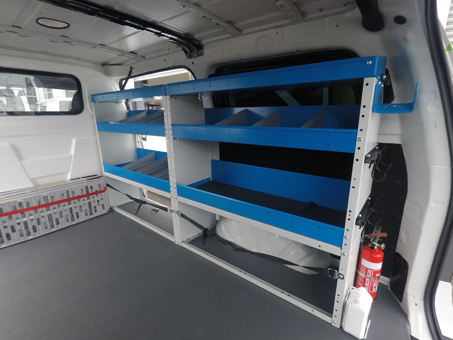 Commercial van fitout with shelves