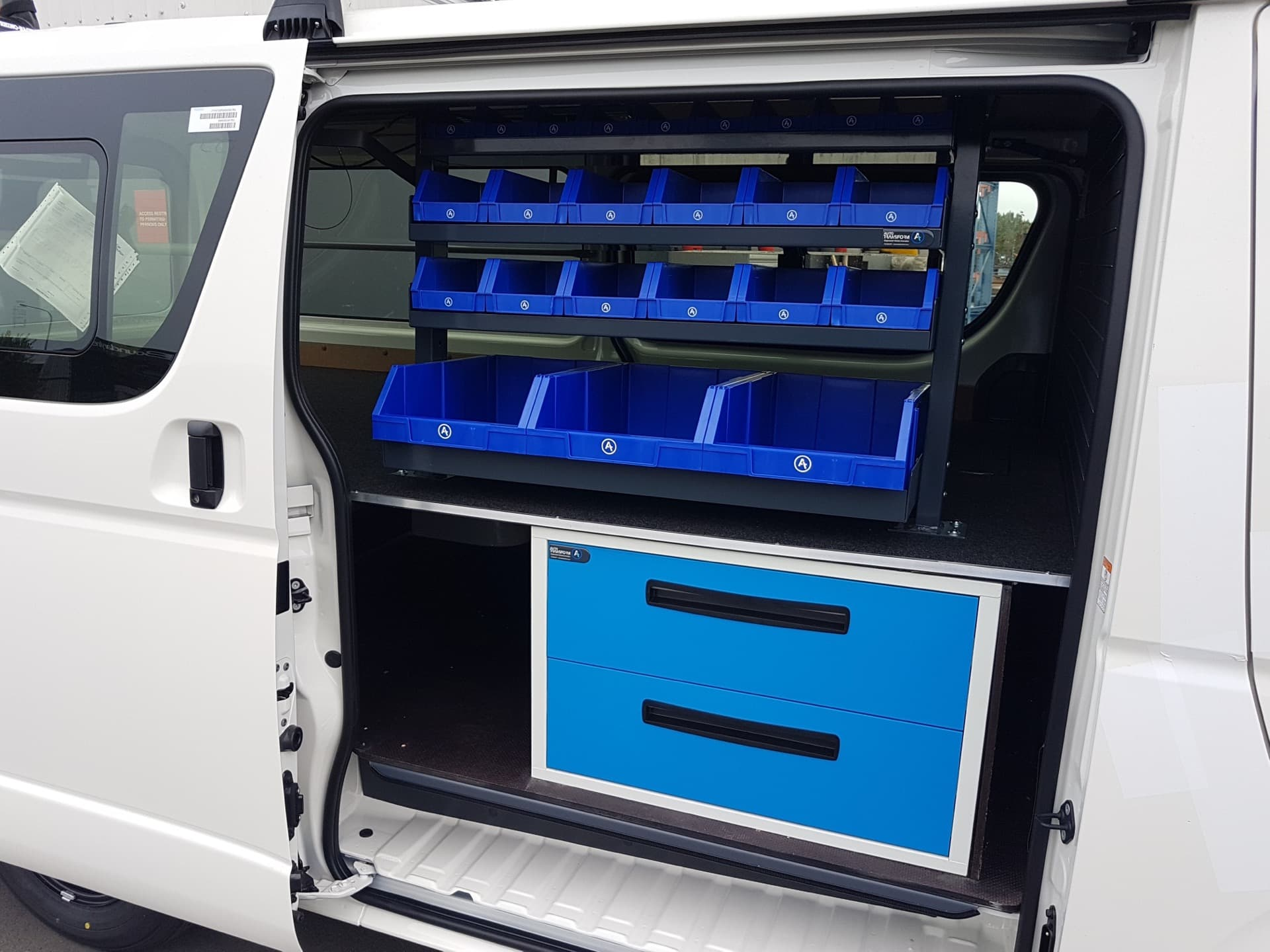Commercial van fitout with syncro system parts bins and drawers