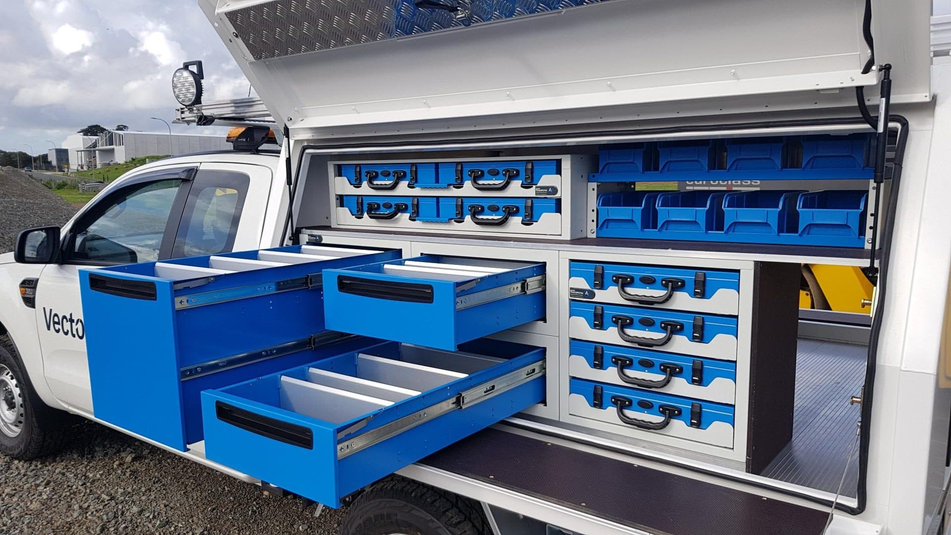 Modular plastic drawers and shelving for ute service body