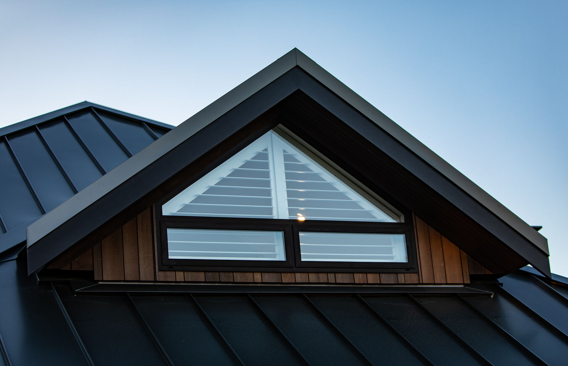 Cedar cladding and seamlock roofing.