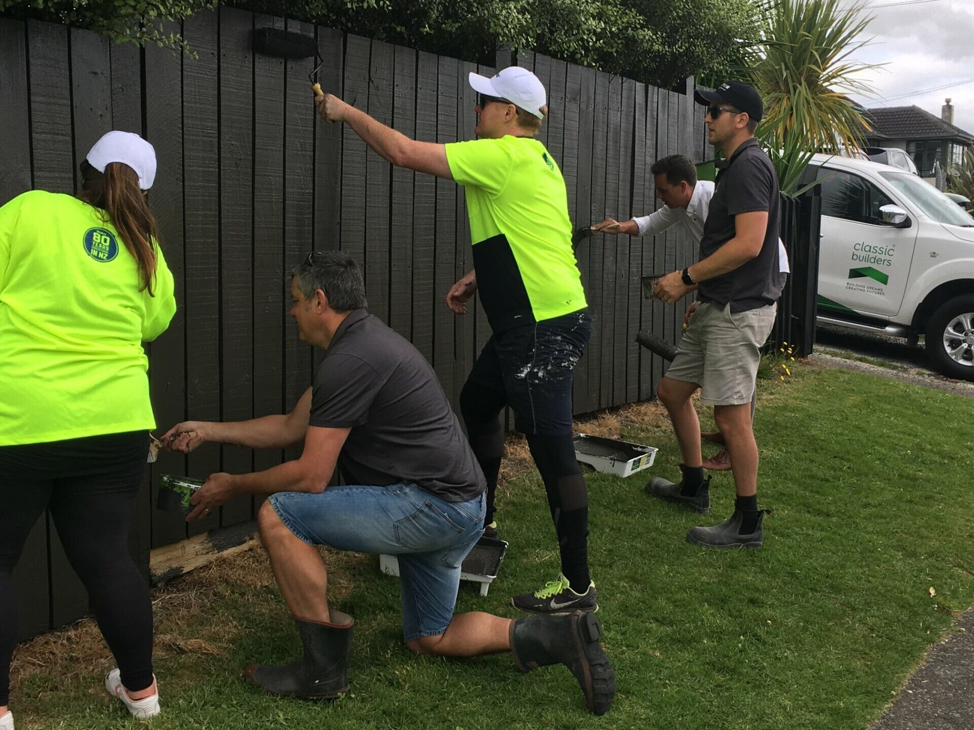 BOP Team painting fence for Good Neighbour
