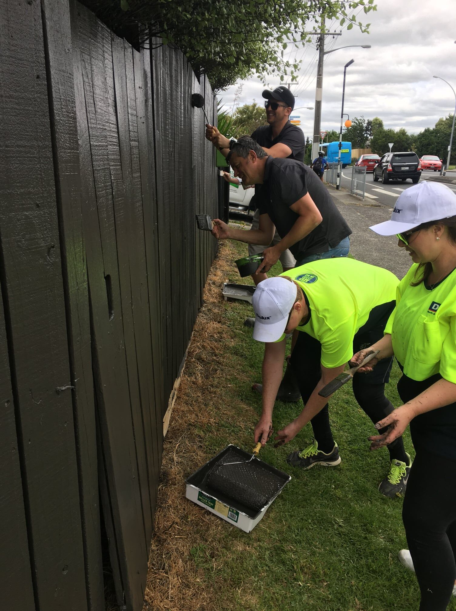 BOP Team painting fence