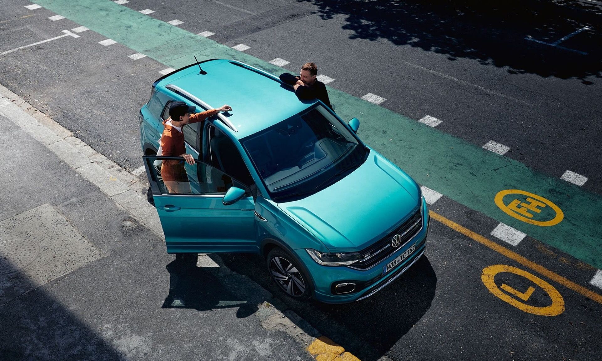 vw t cross aerial view with two people