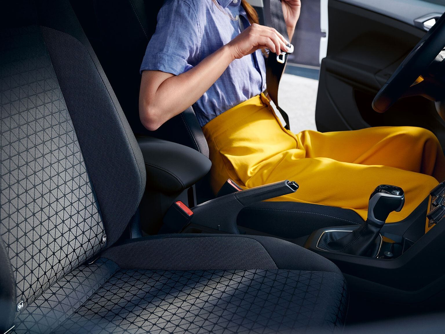 vw t cross interior with passenger seat and woman on driver seat