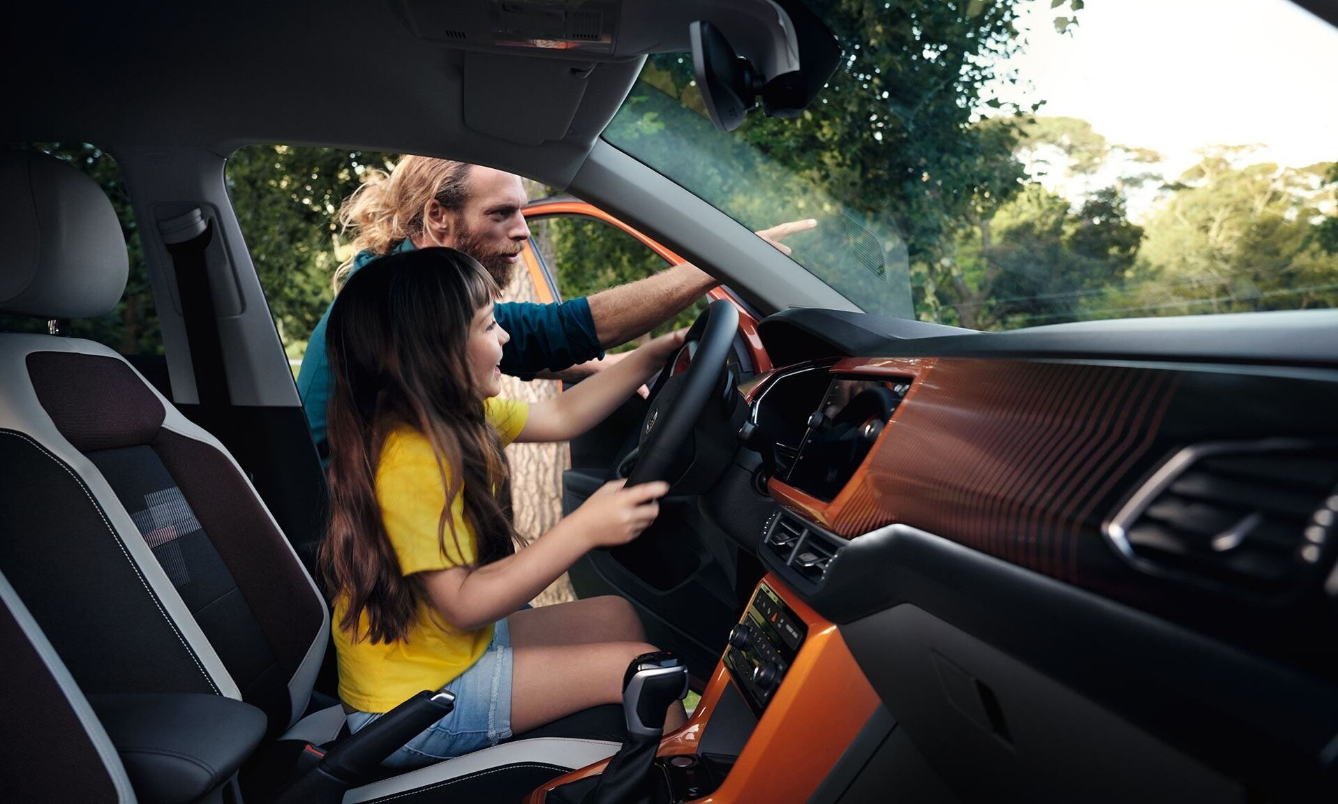 vw t cross interior with woman looking on smartphone