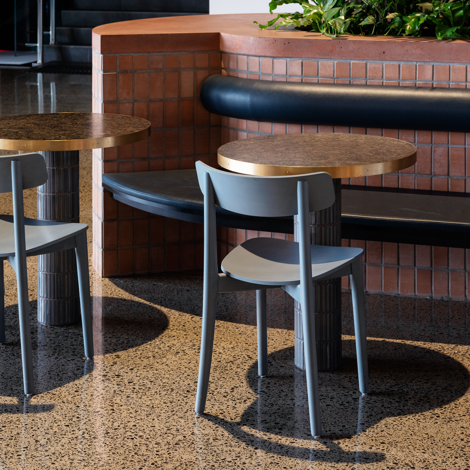 Stained Babar Chairs bring soft tones to a busy foodcourt