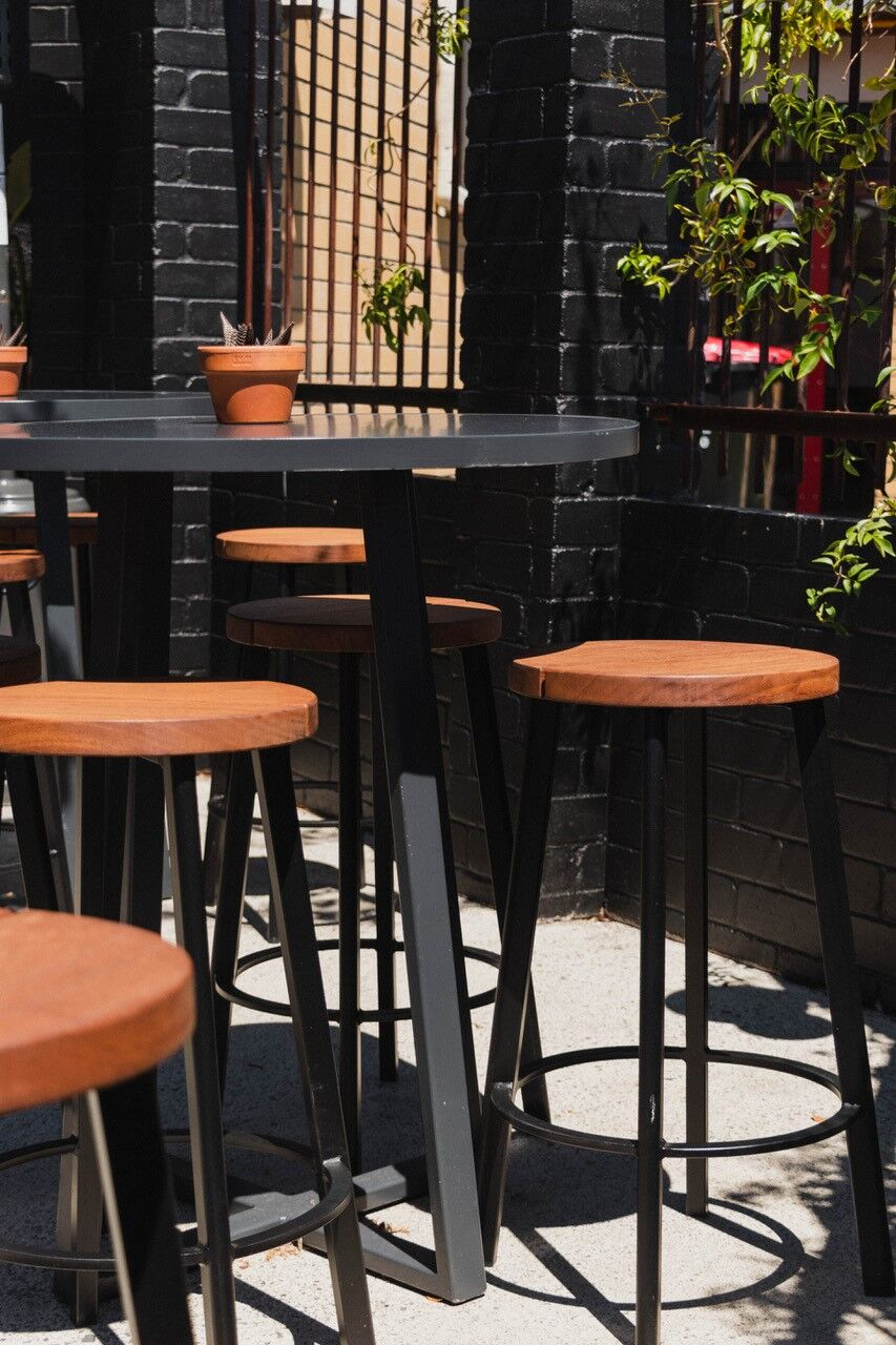 The alfresco dining at Neighbourhood Kitchen features Joi Twenty Chairs, Astro Stools and the Extant Collection