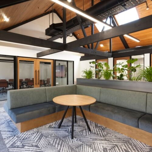 Comfortable banquette seating in the office space - ITM Head Office fitout by Stack Interiors