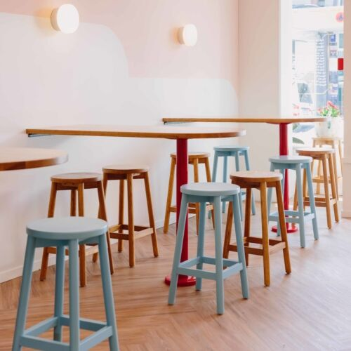 A mix of Mode Stools provide the perfect place to either wait or enjoy an ice cream