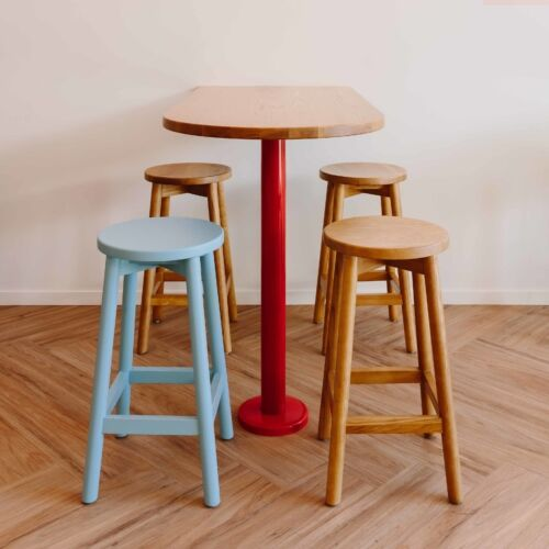 Bold red powdercoated bases bring a pop of colour