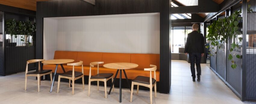Poise Timber Cafe Tables in front of Solace Banquettes - ITM Head Office fitout by Stack Interiors