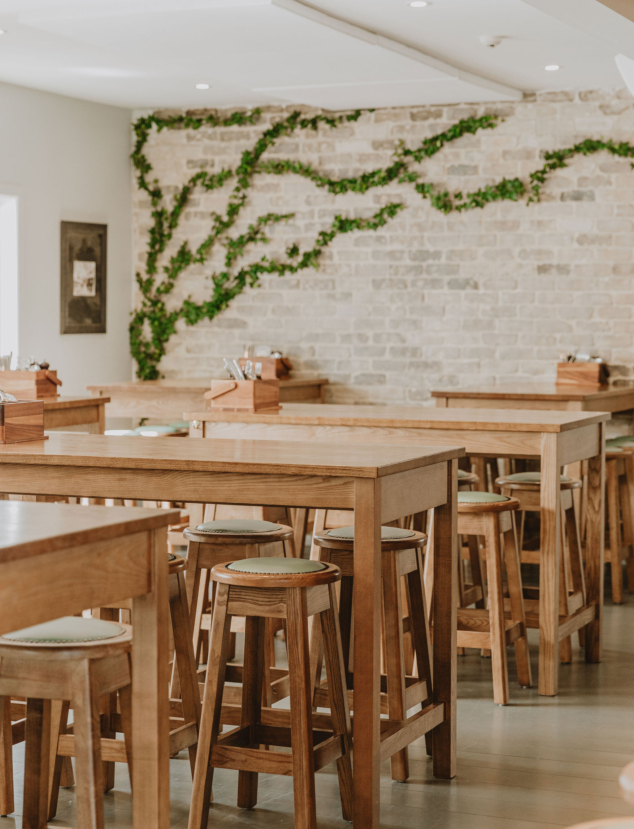 Solid timber leaners are paired with timber stools