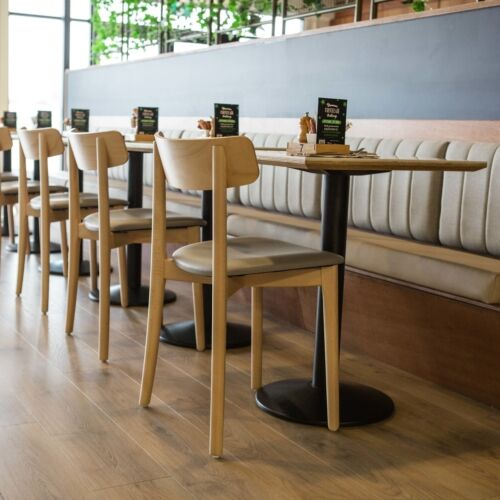 Babar Chairs stained in Clear and upholstered in a soft grey vinyl