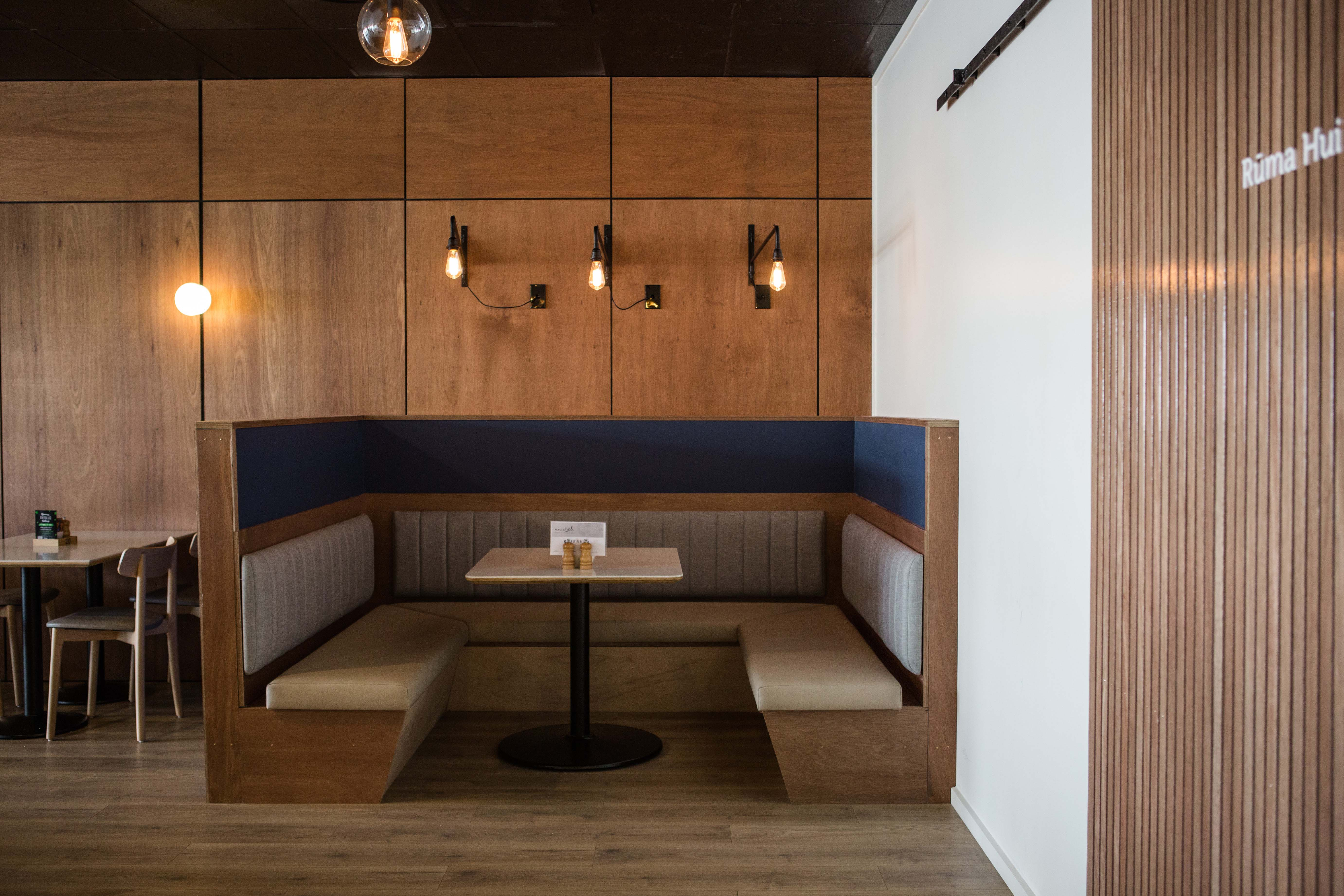 A Case Table Top centered in a cosy banquette setting