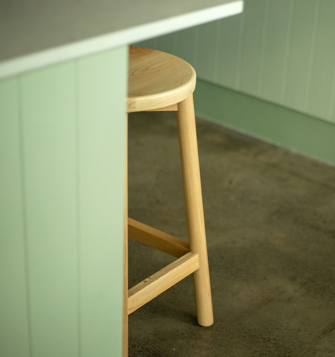 A detail shot of the clear timber Mode Stools 650 at Benedicts Cafe