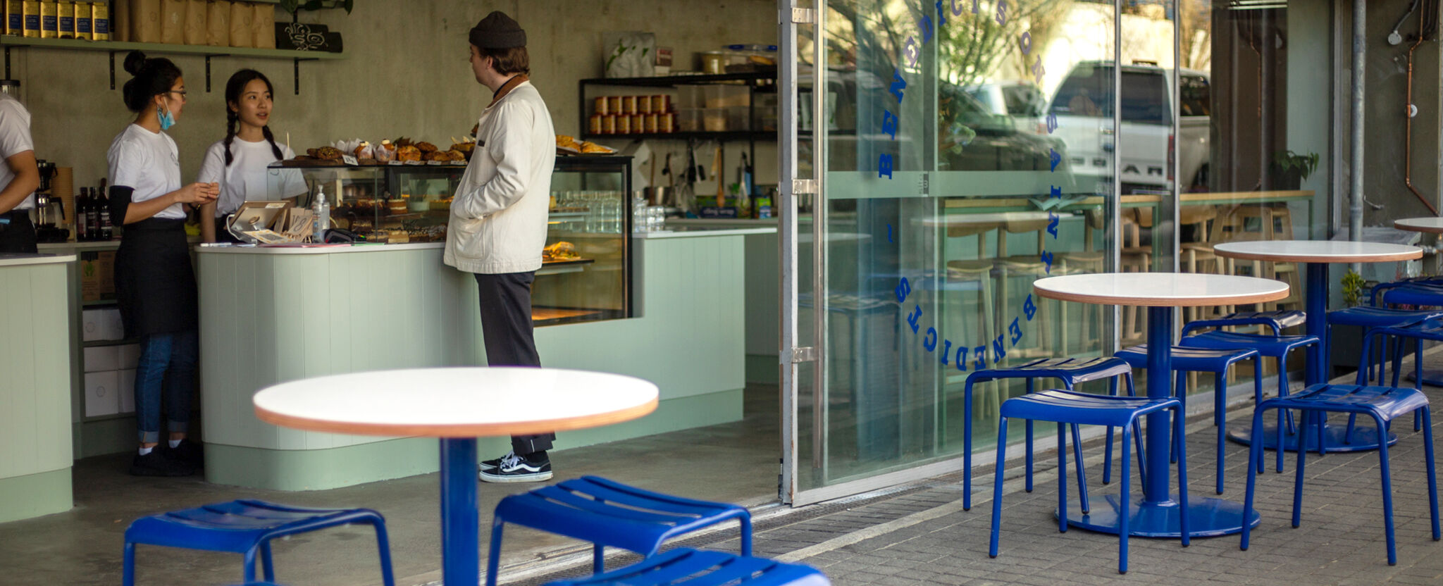 Outdoor seating with a cheerful vibe at Benedict's Cafe in Eden Terrace