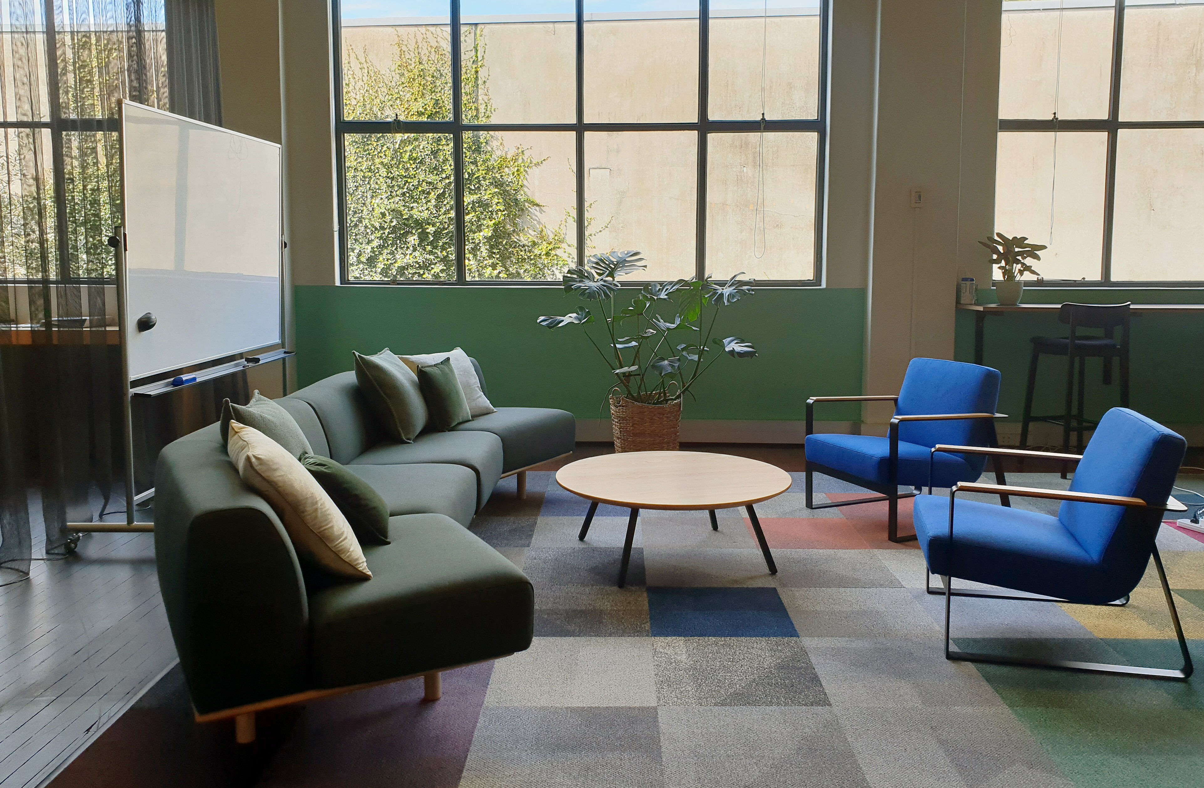 An eclectic collection of furniture styles and colours creates a creative oasis at Context Architects