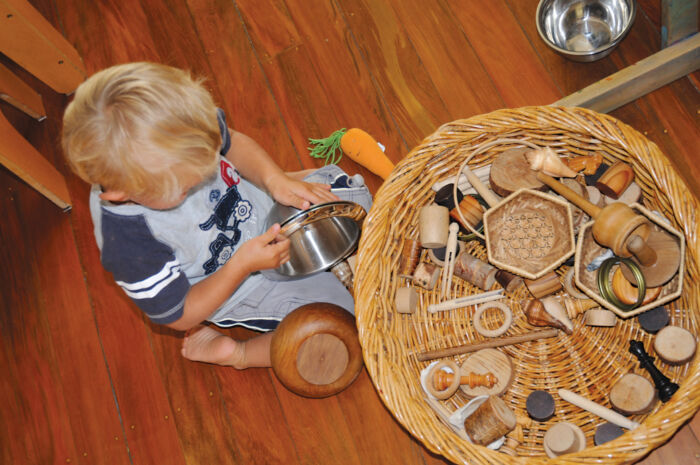 child playing with natural toys