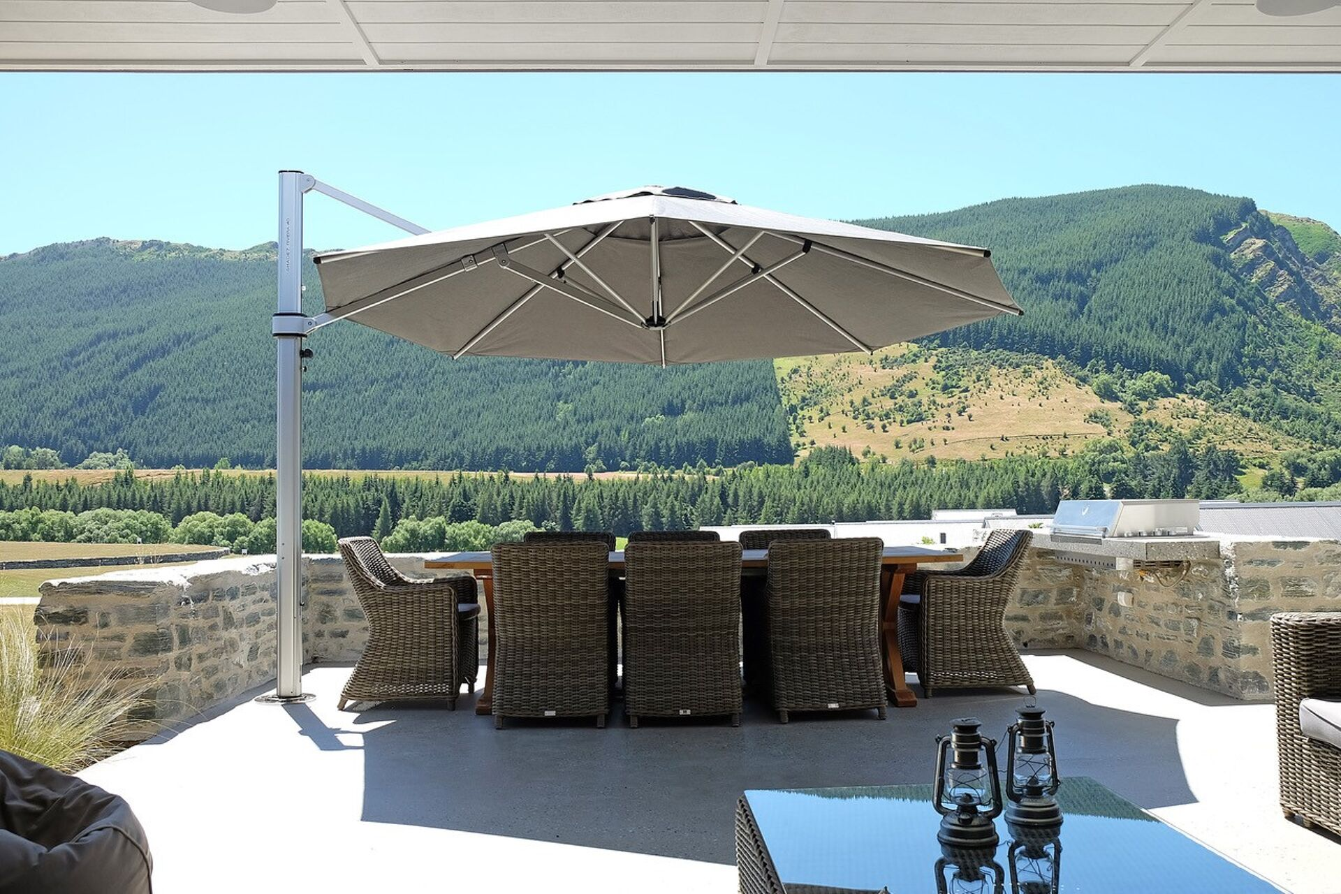 outdoor cantilever umbrellas seen against hills