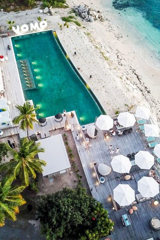 Monaco outdoor umbrella at Vomo pool