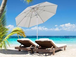 Tilting White Outdoor Umbrella on Beach