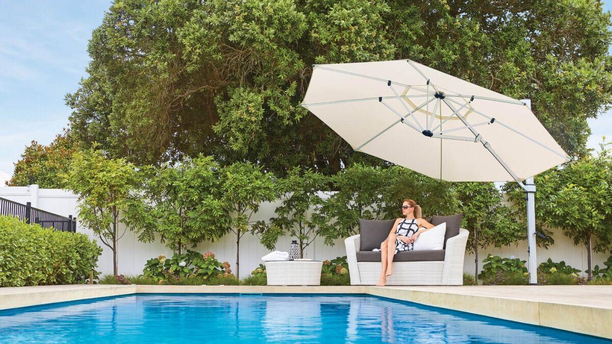 White Riviera Cantilever Umbrella by Pool